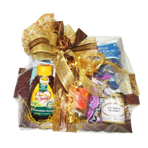 Gourmet gift hamper in wooden tray